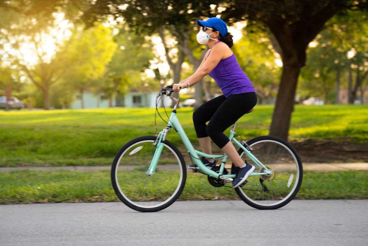 woman biking in park | bike stores in Louisville