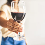 woman holding glass of wine | wine in Louisville