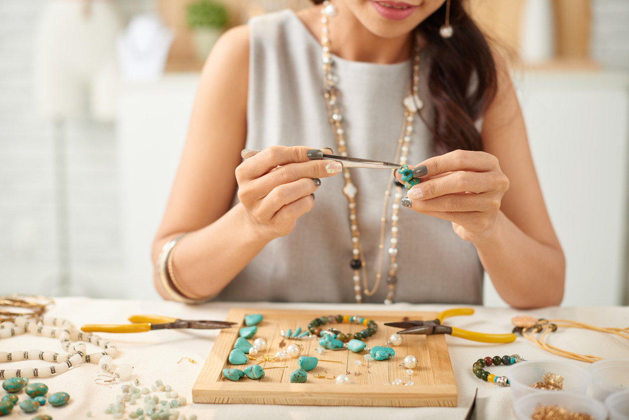 woman making jewelry | craft stores in Louisville